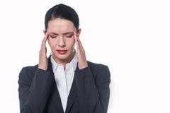 Empresaria bonita elegante con dolor de cabeza Foto de archivo libre de regalías