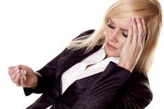 Empresaria con dolor de cabeza. Imagenes de archivo