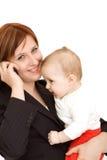 Empresaria con el bebé Foto de archivo