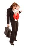 Empresaria con el bebé Foto de archivo libre de regalías