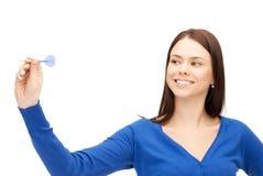 Empresaria con el dardo Foto de archivo libre de regalías