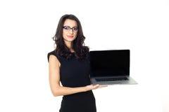 Empresaria con el ordenador portátil Foto de archivo