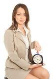 Empresaria con el reloj de alarma Foto de archivo libre de regalías