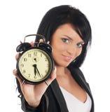 Empresaria con el reloj de alarma Foto de archivo