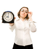 Empresaria con el reloj de alarma (foco en el reloj) Imágenes de archivo libres de regalías