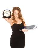 Empresaria con el reloj de alarma (foco en mujer) Imágenes de archivo libres de regalías