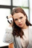 Empresaria con el teléfono Foto de archivo libre de regalías