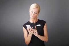 Empresaria con el teléfono Imagen de archivo