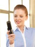 Empresaria con el teléfono celular Imagen de archivo libre de regalías