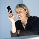 Empresaria con el teléfono celular. Imagenes de archivo