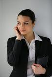 Empresaria con el teléfono móvil Imágenes de archivo libres de regalías