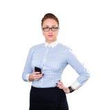Empresaria con el teléfono móvil a disposición Foto de archivo libre de regalías