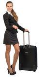 Empresaria con la maleta rodada, mostrando fotos de archivo libres de regalías