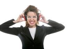 Empresaria con los auriculares de la seguridad del ruido fotografía de archivo