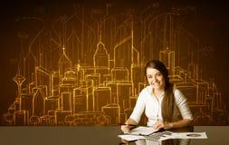 Empresaria con los edificios y los números Imagen de archivo libre de regalías