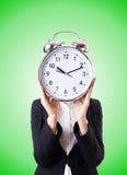Empresaria de la mujer con el reloj gigante Imágenes de archivo libres de regalías