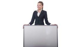 Empresaria de la mujer con el tablero en blanco Imagen de archivo libre de regalías
