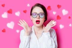 Empresaria del pelirrojo con los corazones abstractos Fotografía de archivo libre de regalías