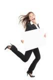Empresaria divertida que se ejecuta con la muestra de la cartelera Foto de archivo libre de regalías