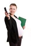 Empresaria embarazada con un teléfono celular Imagen de archivo