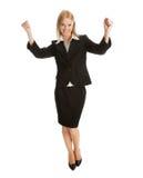 Empresaria emocionada que celebra éxito Imagen de archivo