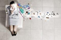 Empresaria en silla Imagen de archivo libre de regalías