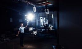 Empresaria en su oficina Técnicas mixtas Imagenes de archivo