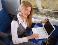 Empresaria en tren Fotos de archivo libres de regalías