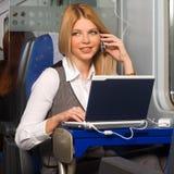 Empresaria en tren Foto de archivo