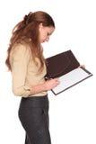 Empresaria - escritura en la libreta Foto de archivo libre de regalías
