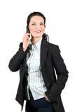 Empresaria feliz confidente en móvil del teléfono Imagen de archivo libre de regalías