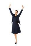 Empresaria feliz joven con las manos para arriba Foto de archivo libre de regalías