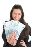 Empresaria feliz que muestra el dinero Imagenes de archivo