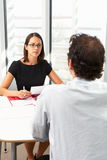 Empresaria Interviewing Male Candidate Foto de archivo