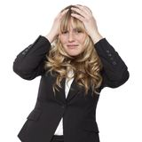 Empresaria joven con un dolor de cabeza Imagenes de archivo