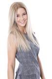 Empresaria joven hermosa sonriente sobre el fondo blanco. Fotografía de archivo
