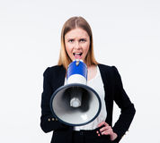 Empresaria joven que grita en megáfono Imagenes de archivo