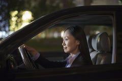 Empresaria madura Driving Car fotos de archivo libres de regalías