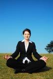 Empresaria meditating imagen de archivo