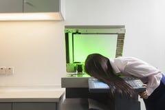 Empresaria Photocopying Her Face Fotografía de archivo libre de regalías