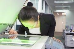 Empresaria Photocopying Her Face Fotos de archivo