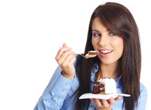 Empresaria que come la torta Fotografía de archivo