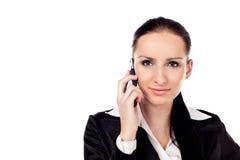 Empresaria que habla en el teléfono. Aislado Foto de archivo libre de regalías
