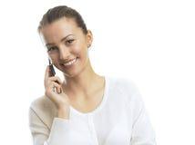 Empresaria que habla en el teléfono móvil Imágenes de archivo libres de regalías