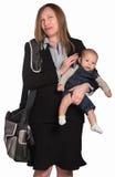 Empresaria que llora con el bebé Fotografía de archivo libre de regalías