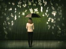 Empresaria que se coloca con el paraguas y el llover de los números 3d concentrado Imágenes de archivo libres de regalías