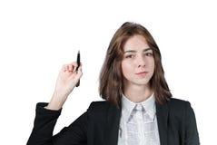 Empresaria que sostiene la pluma en su mano Foto de archivo