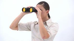 Empresaria que sostiene los prismáticos metrajes