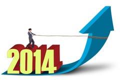 Empresaria que tira del Año Nuevo 2014 Fotografía de archivo