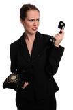 Empresaria que usa el teléfono de la vendimia Fotos de archivo